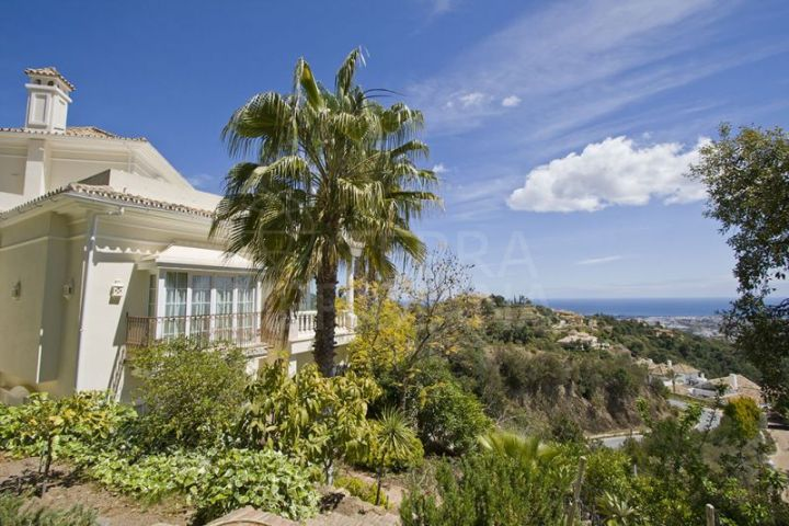 Elegant villa with extensive private grounds and scenic views for sale in La Zagaleta Country Club, Benahavis
