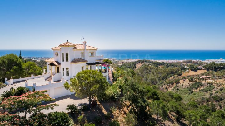 An impressive luxury hillside villa with superb sea and country views for sale in Los Reales, Sierra Estepona