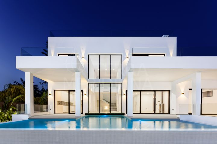 Stunning new 5 bedroom modern villa for sale beachside in Elviria with glass panel private pool