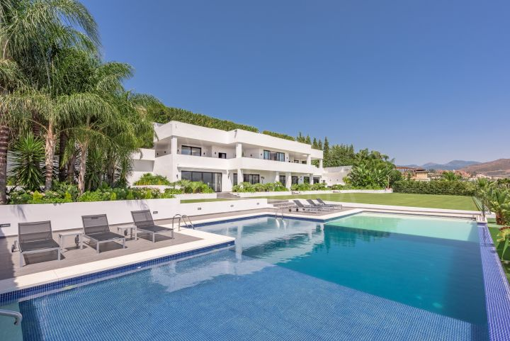New build 7 bedroom luxury modern villa for sale in Nueva Andalucia, with indoor and outdoor pools, lift, gym and spa