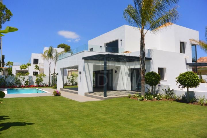 Beachside Contemporary villa with pool and sea views, for sale in the New Golden Mile, Estepona