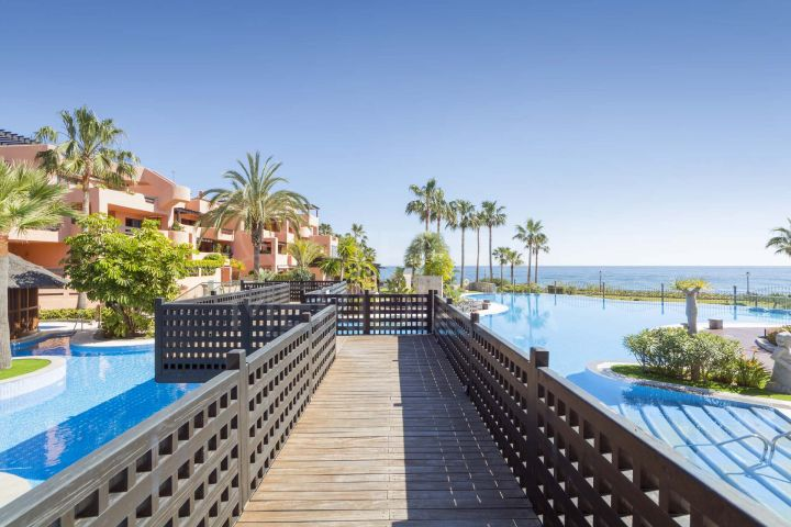 2 bedroom ground floor apartment with private garden for sale, front line beach in Mar Azul, Estepona