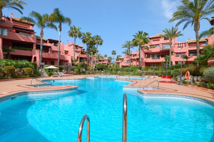 Spacious ground floor apartment in the luxury seafront development of Menara Beach, New Golden Mile, Estepona
