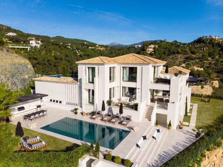 A striking trophy residence with scenic views for sale in the affluent private community of El Madroñal, Benahavis