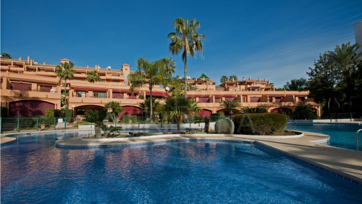 Luxury front line townhouse with private garden and sea views for sale in the exclusive beachfront development of Riviera Andaluza, Estepona