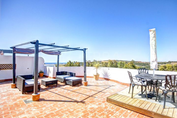 Sunny 2 bedroom front Line golf penthouse for sale in Estepona Golf