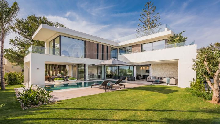 Sleek contemporary beachside villa with sea views showcasing unparalleled quality for sale in Marbesa, Marbella East