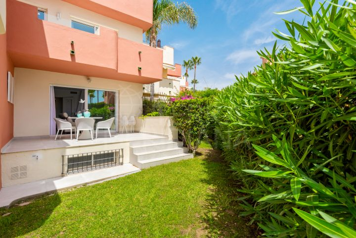 Frontline beach renovated luxury townhouse walking distance to Estepona centre for sale in Garden Beach, New Golden Mile, Estepona