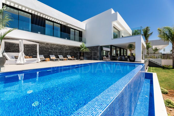 Striking contemporary villa with mesmerising coastal views for sale in Los Flamingos, Benahavis