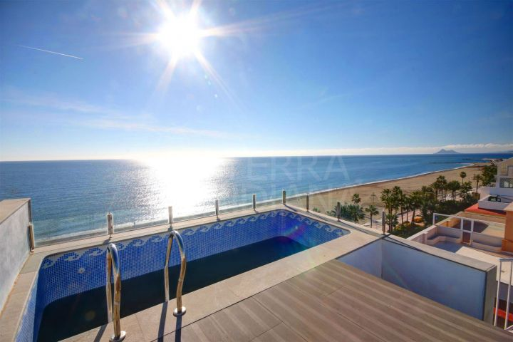 2 penthouses for sale to reform and join together in the centre of Estepona, front line beach with panoramic sea views and private swimming pool