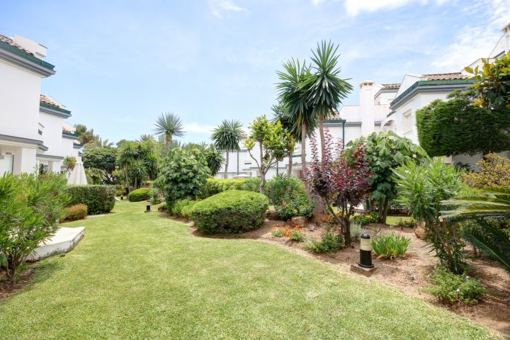 Townhouse for sale in exclusive front line beach complex of Dominion Beach in Estepona