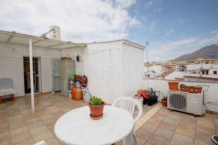 Townhouse with separate apartment for sale in the old town of Estepona, with mountain views