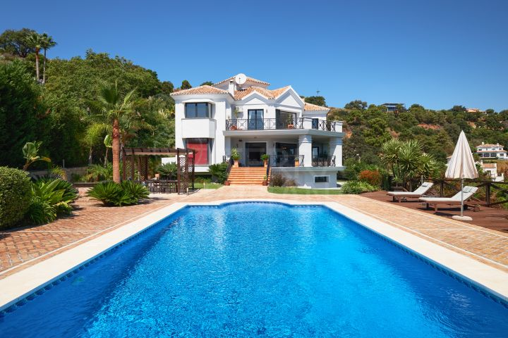 Sizeable luxury villa with breathtaking coastal views for sale in privileged Monte Mayor Country Club, Benahavis