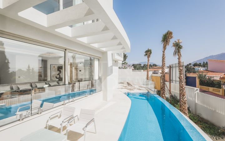 Recently completed contemporary luxury villa with sleek and sophisticated interiors for sale in Nueva Andalucia, Marbella