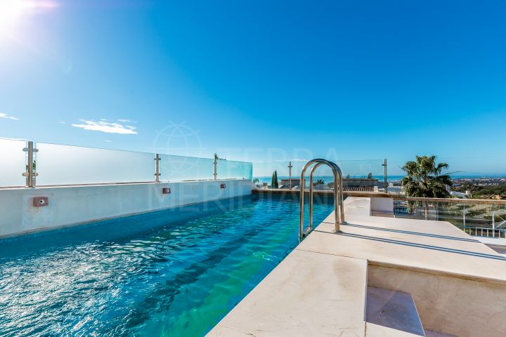 Luxury townhouse with rooftop pool and sea views for sale in Sierra Blanca del Mar, Marbella