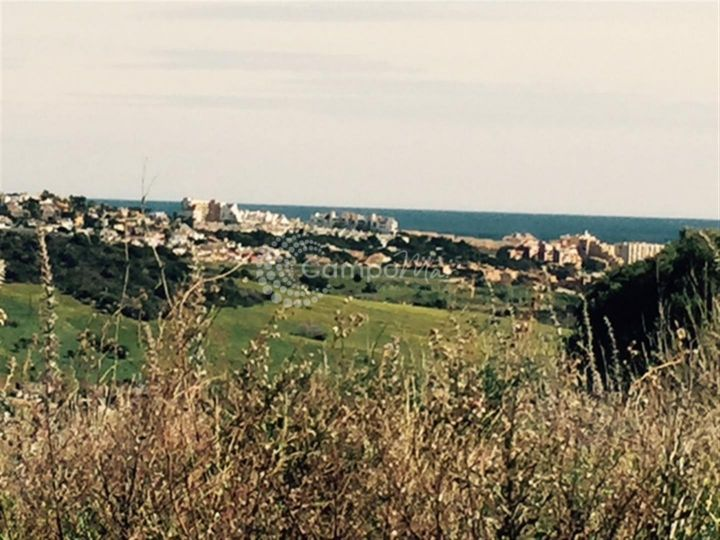 Estepona, Large plot for sale with golf and sea views in Estepona