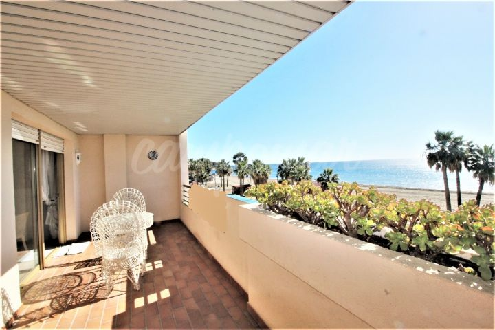 Estepona, Front line beach apartment in Estepona for sale.