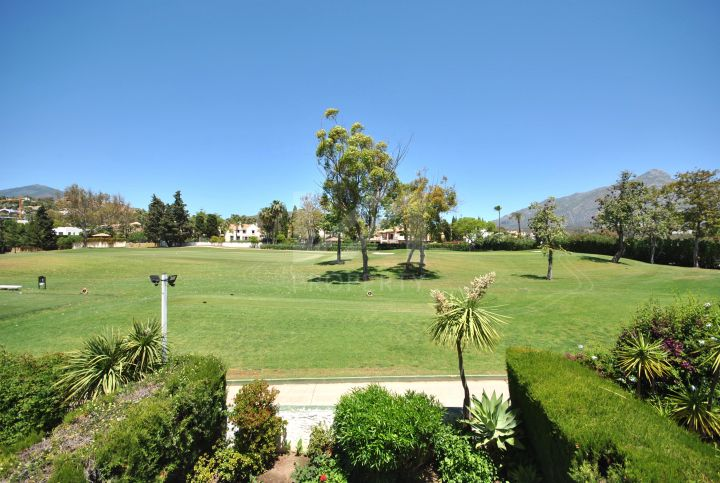 Fantastic frontline golf townhouse in gated community with security in Los Naranjos Country Club, Nueva Andalucia.