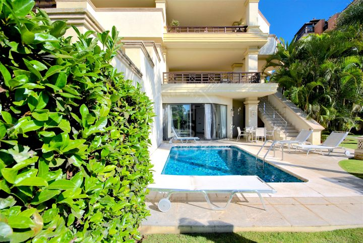 Balinese style duplex apartment with private pool and garden in frontline beach development Laguna de Banus
