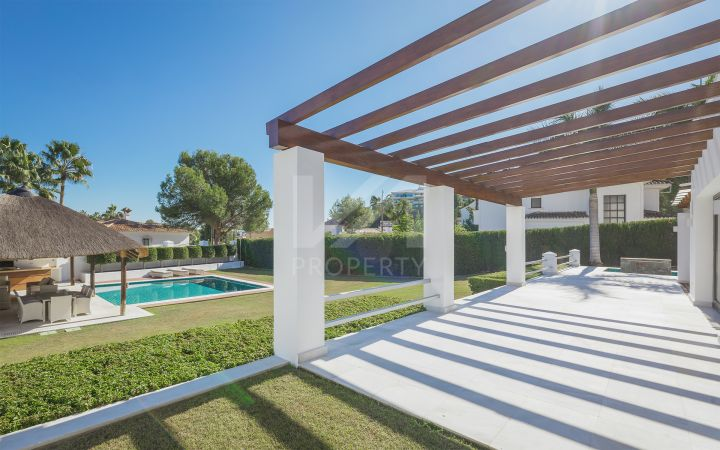 Impressive villa besides Centro Plaza within walking distance to amenities, the beach, and Puerto Banus.
