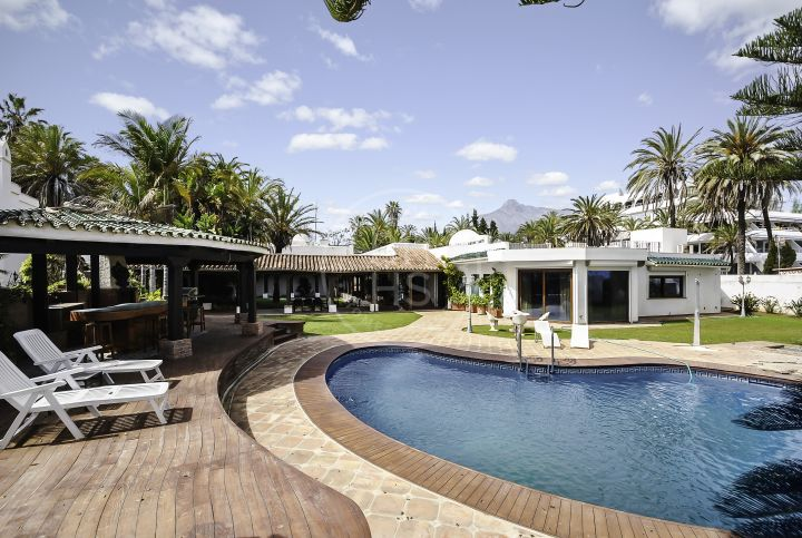 Unique beachfront villa set in Marbella's most desirable address, The Golden Mile.