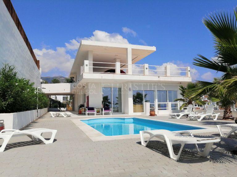 Modern villa with stunning views of the Mediterranean.