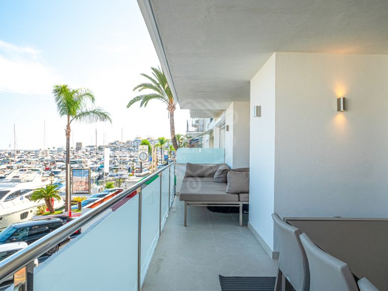 Renovated apartment frontline the Marina of Puerto Banus