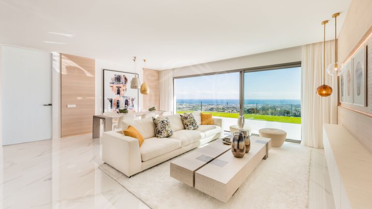 Stunning new middle floor with panoramic sea and golf views