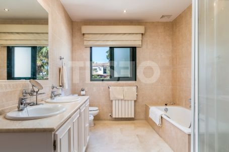 Elegant andalucian style villa with a south facing aspect and offering super views over a green zone to San Roque and Almenara Golf Courses