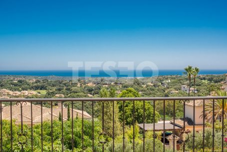 Substantial villa with superb unobstructed golf, sea and mountain views.