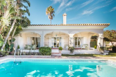 MAINTAINED IN IMMACULATE ORDER, THIS VILLA IS PEACEFULLY LOCATED IN A MATURE AREA WITH PRETTY GARDENS FOR SALE
