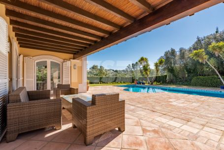 Charming family villa with pretty south facing gardens and lovely views to 2 golf courses