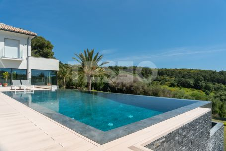 Magnificent 3 storey front line golf villa in La Reserva , with panoramic golf and sea views.
