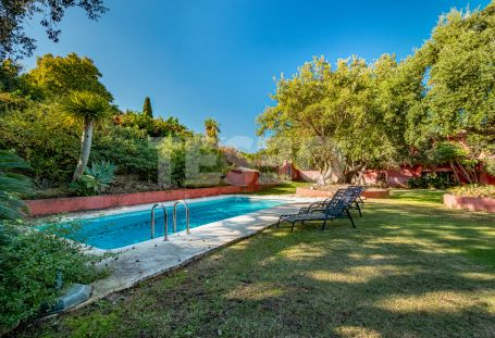 Beautiful Andalusian 2 storey villa situated in a sought after area of Sotogrande Alto with cork trees and larga garden.