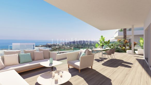 New development of modern-style apartments with sea views in Estepona