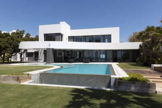 Modern beachside villa for sale in Marbella East, Spain