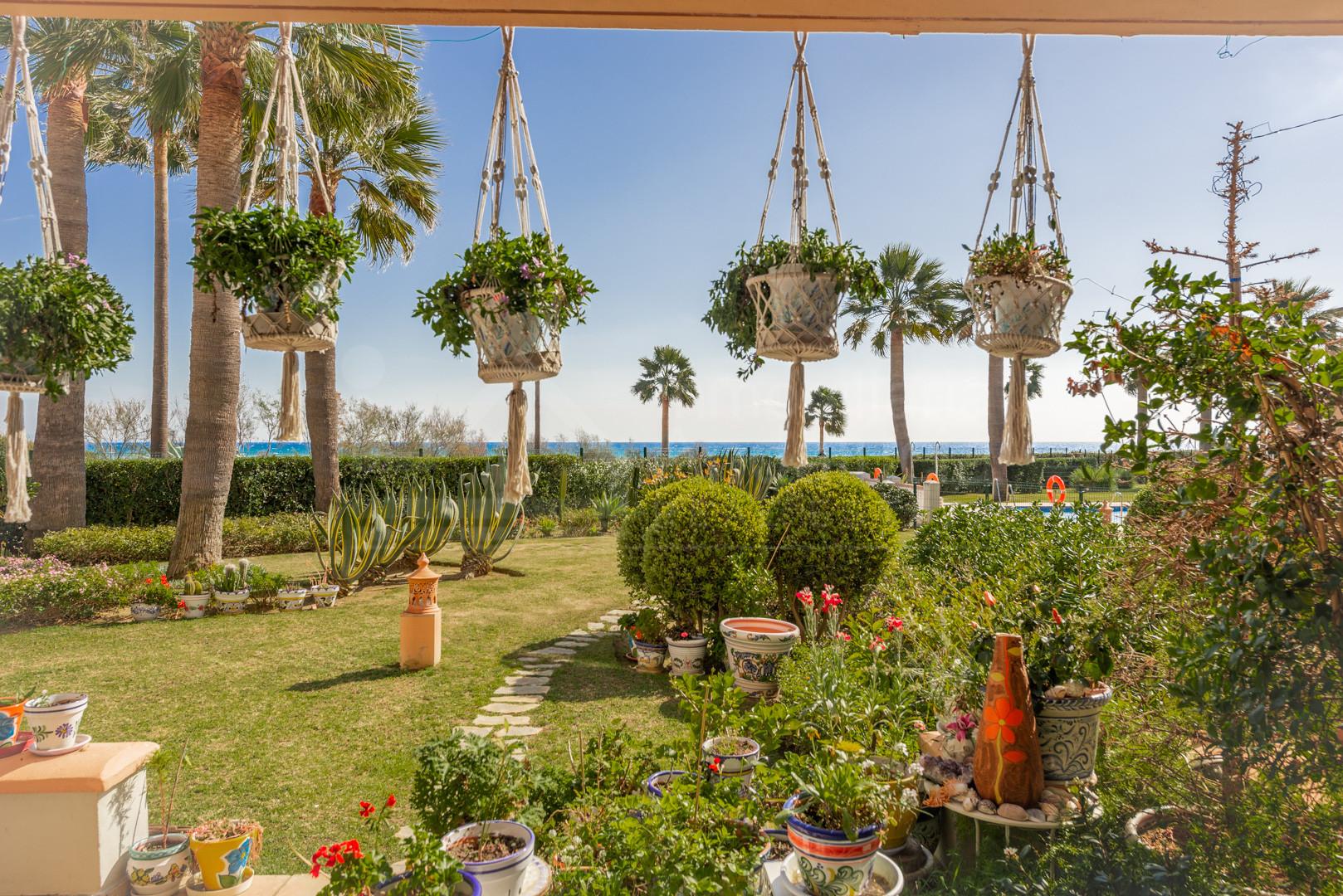 Enjoy the sea breeze from this stunning front line beach 2 beds In La Perla de La Bahía