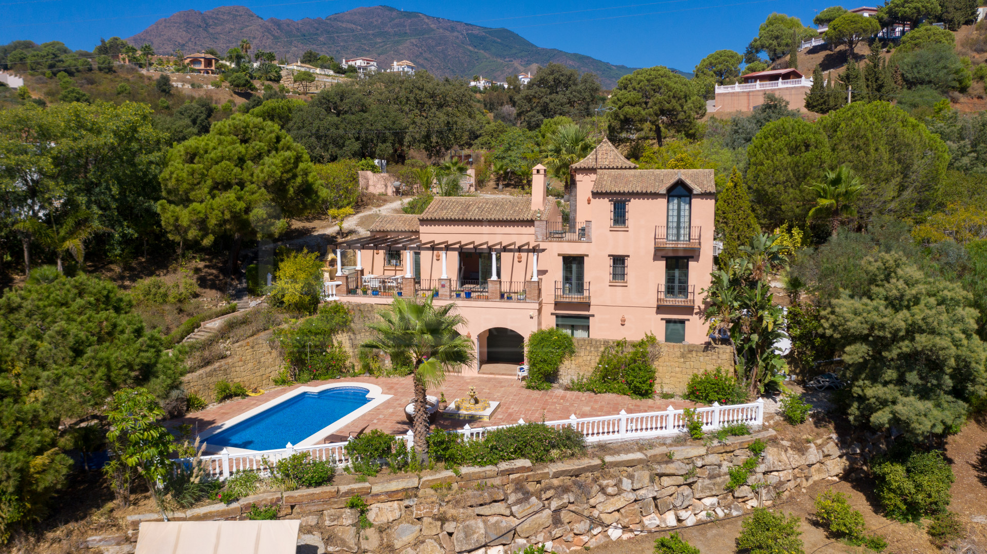 Four bedroom country villa for sale with elevated sea views in Los Reales, Estepona